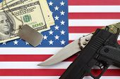Close Up Dollar Money With Weapons And Military Badges On United States Flag. Military Forces, Finan poster