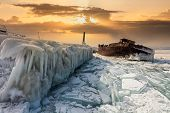 The Icy Old Ship On Lake Baikal At Sunset. Siberia, Russia poster