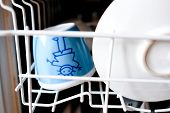 Childrens Dishes In The Dishwasher. Clean Mug And Saucer poster