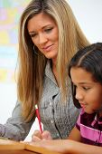 pic of student teacher  - Teacher and Student In A Classroom At School