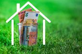 Euro Bank Notes In A Glass Jar In Garden. Saving Money For Residential Or Retire. poster