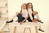 Schoolgirls Friends Sit On Desk. Best Friends Relaxing. Schoolgirls Tidy Hairstyle Relaxing Having R poster