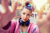Cool Funky Young Girl With Headphones And Crazy Hair Enjoy Power Of Music Taking Selfie On Street -  poster