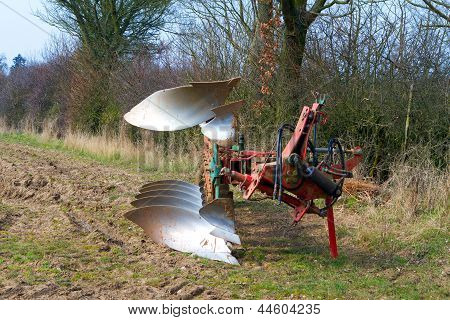 Agricultural Plough Machine In A Field In The Spring