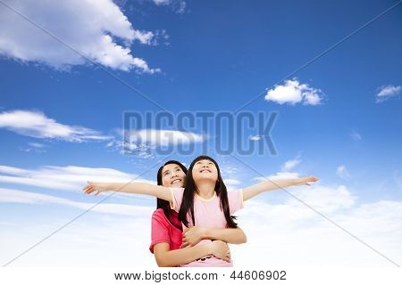 Happy Little Girl And Mother Watching The Sky