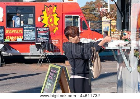 Customer Buys Meal From Food Truck