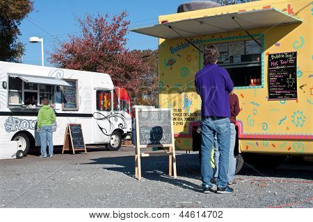 People Wait In Line For Food Truck Vendors