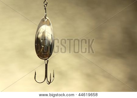 Wet steel fishing lure close-up