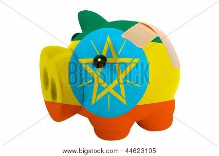 Closed Piggy Rich Bank With Bandage In Colors National Flag Of Ethiopia