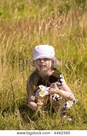 Portrait Of A Beautiful Girl In Hat On Meadow