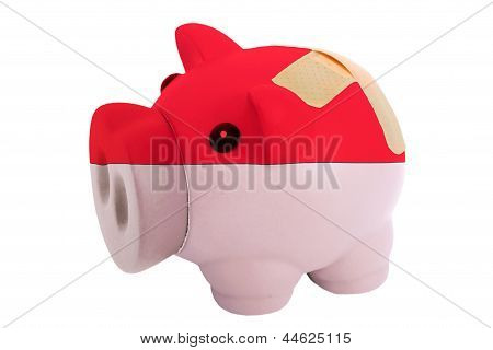 Closed Piggy Rich Bank With Bandage In Colors National Flag Of Indonesia