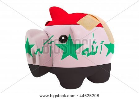 Closed Piggy Rich Bank With Bandage In Colors National Flag Of Iraq