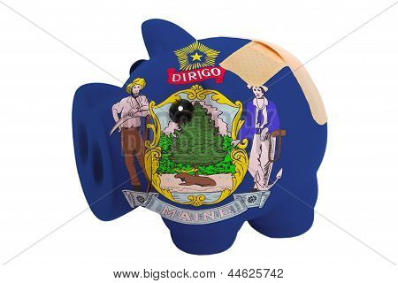 Closed Piggy Rich Bank With Bandage In Colors Flag Of American State Of Maine