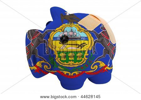 Closed Piggy Rich Bank With Bandage In Colors Flag Of American State Of Pennsylvania