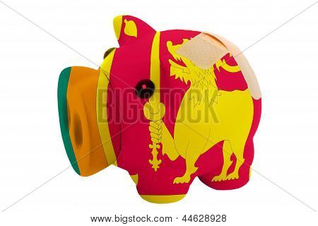 Closed Piggy Rich Bank With Bandage In Colors National Flag Of Srilanka