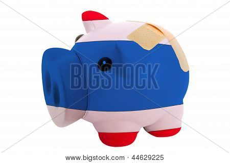 Closed Piggy Rich Bank With Bandage In Colors National Flag Of Thailand
