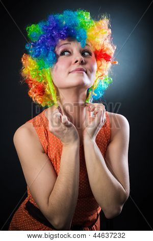 Woman In Clown's Wig Smiling Pulling Fake Hair On The Sides