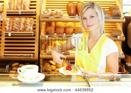Shopkeeper In Baker's Shop Preparing Coffee And Cake