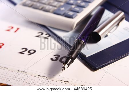 Pen, Calculator, Calendar and Cheque Book