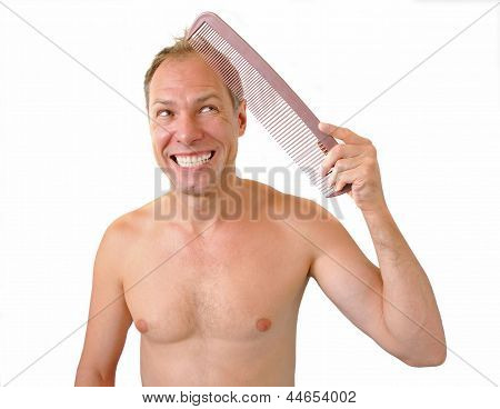Indignant Man Hand Holding Comb On The Head
