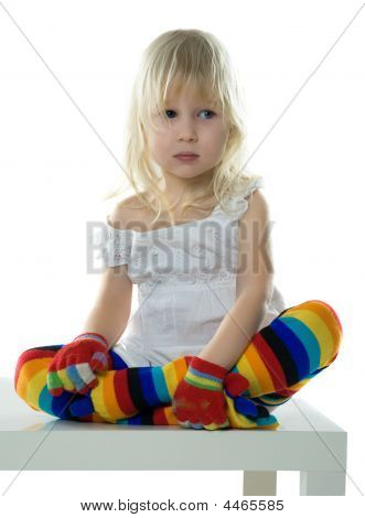 Little Girl Sits On White Chair