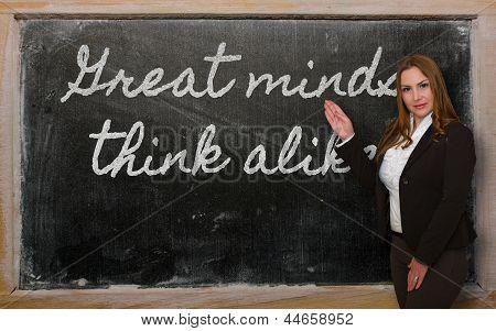 Teacher Showing Great Minds Think Alike On Blackboard