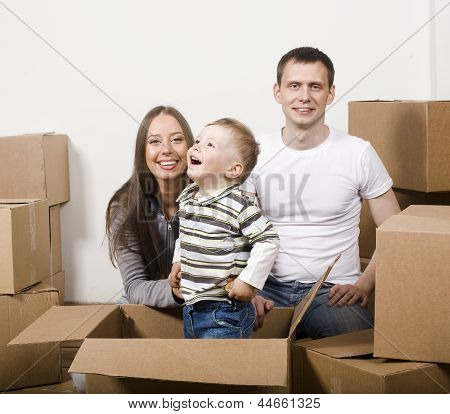 stock photo smiling family in new house playing with boxes