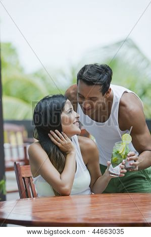Romantic couple having drinks