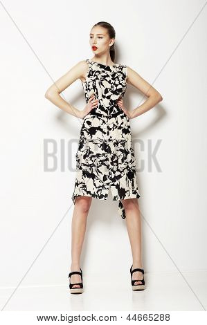 Simplicity. Woman In Ordinary Grey Spotted Summer Dress. Fashion. Series Of Photos
