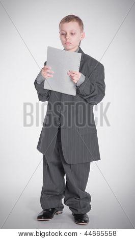 Boy Looks On Paper