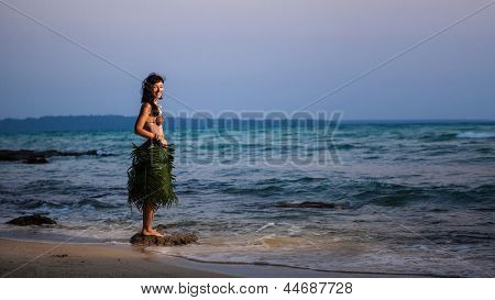 Indigene Woman In The Palm Skirt, Seashells Necklace And Coconut Bra