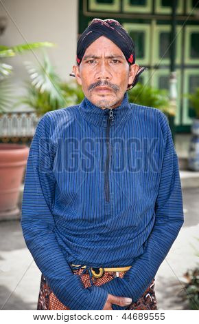 YOGYAKARTA, INDONESIA - DECEMBER 30: Worker in traditional Javanese costume posing in Kraton Sultan Palace, Yogyakarta on December 30, 2011 which is home to the last Sultanate in Indonesia.