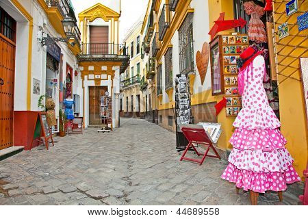 SEVILLE, SPAIN - SEP 11: Shopping street with typical flamenco dress on Sep 11, 2011 in Seville, Spain.