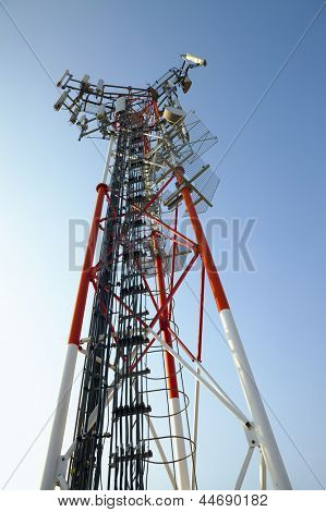 GSM transmitter tower against blue sky