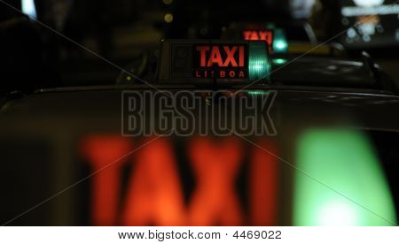 Taxi Rank At Night Waiting For The Next Fare
