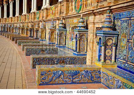 Famous ceramic benches in Plaza de Espana, Seville, Spain. Avila theme art.