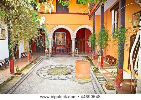 Typical andalusian mudejar courtyard In Seville, Spain.