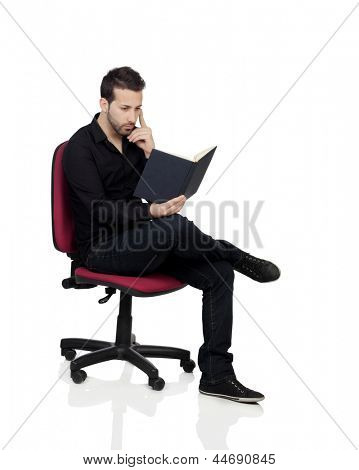 Young Man Reading Book Over White Background
