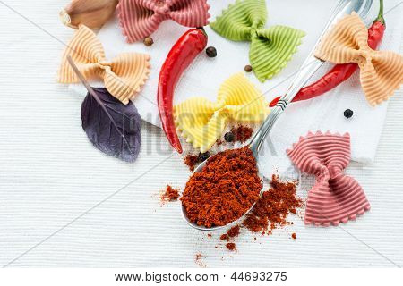 Dry multicolored farfalle pasta and smoked paprika