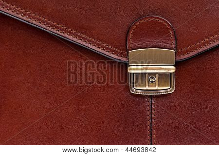 Closeup of leather briefcase with brass buckle
