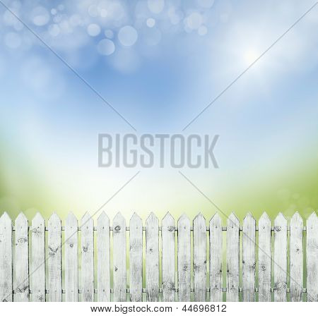 old white fence on a background of blue sky. bokeh