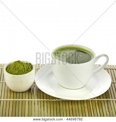 powdered green tea on bamboo napkin texture isolated on white background