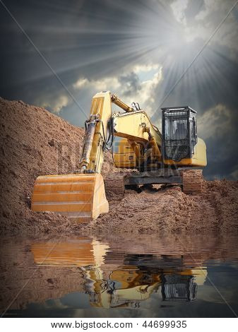 An excavator in old mine. Damaged landscape concept.