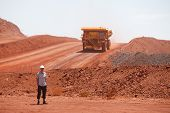 stock photo of mine  - Mining truck working in iron ore mines Western Australia - JPG