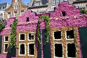 Haarlem, The Netherlands - April 21 2013: Dutch Houses With Flowers At Flower Parade On April 21 201