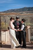 foto of rabbi  - Rabbi reading sacrament for happy lesbian couple marring outdoors - JPG