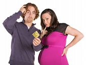 picture of condom  - Man and pregnant woman looking confused with condom - JPG