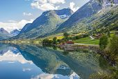 picture of fjord  - Hiking in scenic Norway with mountains reflecting in the fjord water - JPG