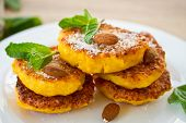 stock photo of dessert plate  - sweet pumpkin pancakes on a plate with mint - JPG