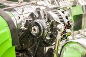 foto of dynamo  - chromed vehicle alternator in a hot - JPG